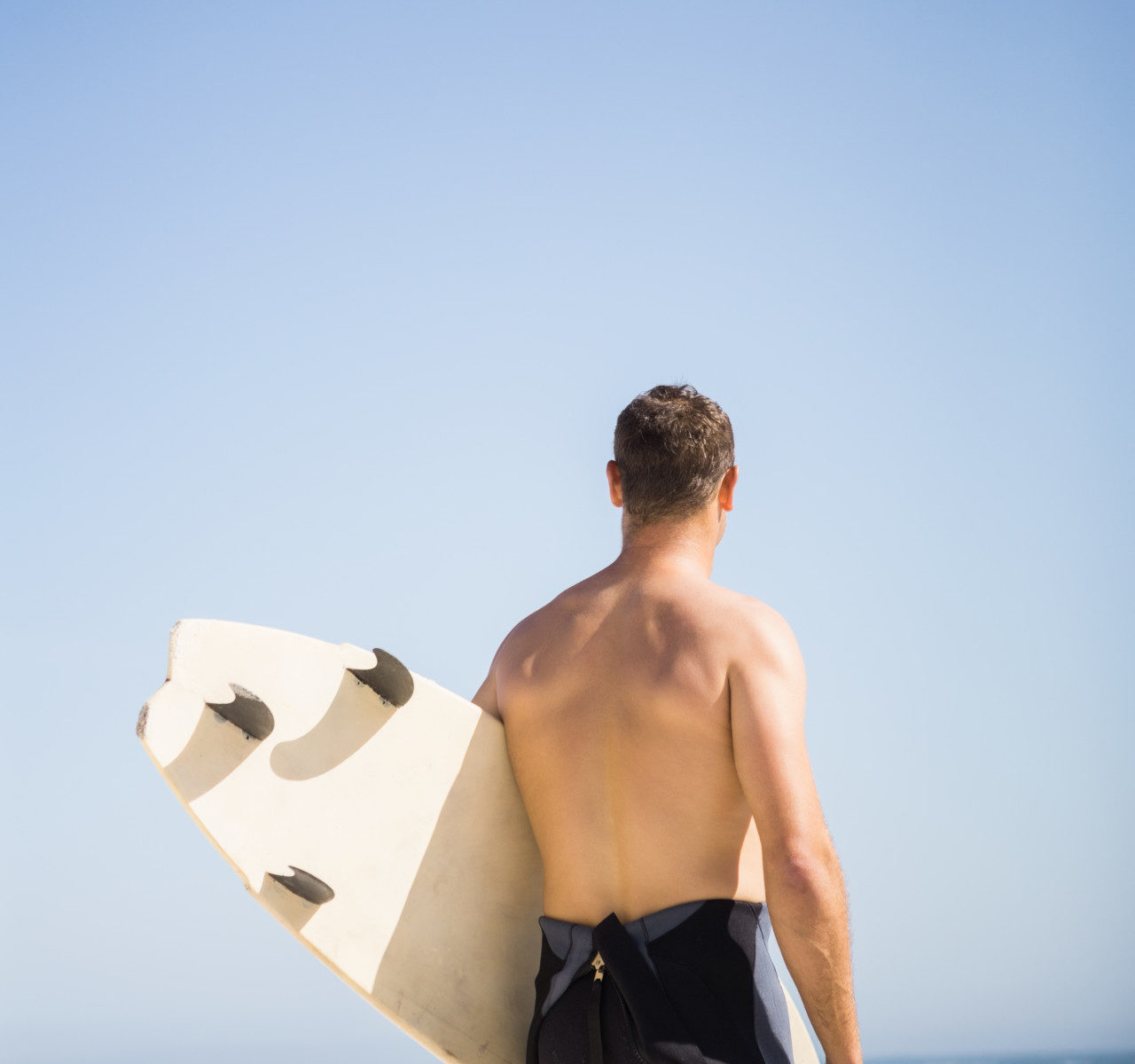 Do Surfers Wear Anything Under a Wetsuit